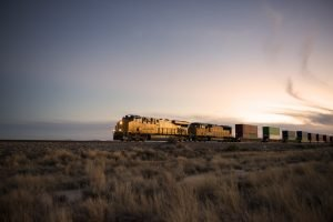 Cargo train travelling through desert.